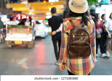tourist, travel and backpack concept. tourist is walking on the street.