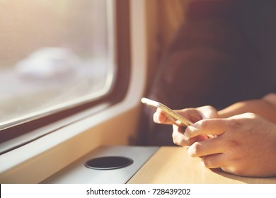 the tourist traveler people use the phone chat and send message on the train.