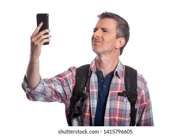 Tourist or traveling hiker unable to get cellphone reception or network.  The man can't make a call or get a rideshare because he has no service or internet. Isolated on a white background.