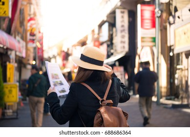 Tourist is traveling into market in Tokyo, Japan.