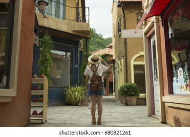Tourist is traveling into old Italian town style.