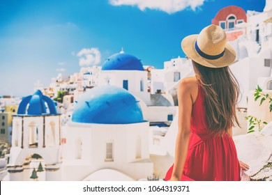 1762c2f1ff7 Tourist traveling in Santorini