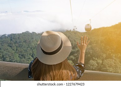 Tourist is traveling with Would Longest cable car on Bana Hill in Danang, Vietnam.
