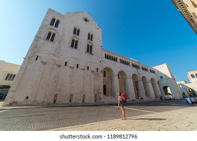 Tourist travelling in Bari looking the famous Saint Nicholas church in Bari, Italy