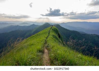 "Tourist treking on top of ""Khao Chang Phueak"" mountain in Thong Pha Phum national park, Kanchanaburi, Thailand, Trekking on bright sunny day of summer."