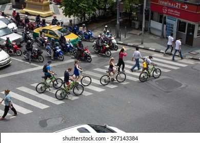 Tourist are using bicycle to sightseeing Bangkok in Asoke junction on July 16,2015