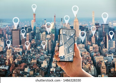 Tourist Using GPS Map Navigation Application On Mobilephone In New York City With Location Pointers
