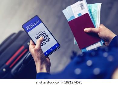 tourist using immunity passport app in mobile phone for travel