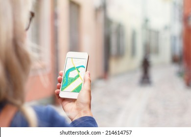 Tourist using navigation app on the mobile phone.