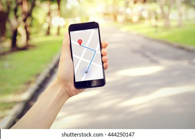 Tourist using navigation app on the mobile phone. Freedom and active lifestyle concept
