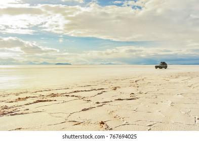 Tourist vehicle driving through Salar Uyuni. Bolivia