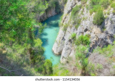 """Tourist village of Montanejos (Castellon - Spain). Mijares, mountain river with thermal and medicinal waters. Near to swimming area of """"The bathes spring"""", on summer season. Soft focus."""