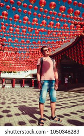 Tourist visit Thean Hou temple, Kuala Lumpur attraction. Travel to Malaysia. Architecture background. Religious concept. City tour. Culture trip. Tourism industry. Man stand under chinese red lanterns