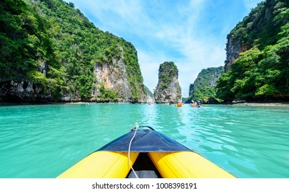 Tourist are visiting by flatwater canoeing. Located in Ao Phang Nga National Park, Phuket, Thailand.