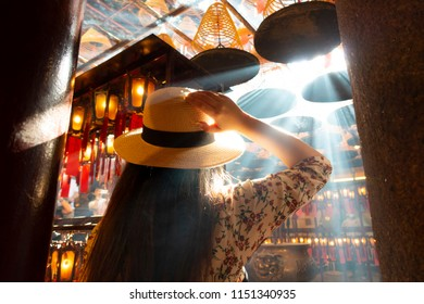 Tourist is visiting Man Mo buddhist temple in Hong Kong.