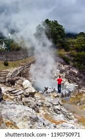 Tourist at Volcano Caldera Hot Springs Fumaroles in Furnas, Sao Miguel, Azores, Portugal