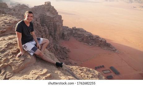 Tourist in the Wadi Rum desert and sandstone landscapes in Jordan.