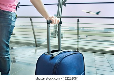 tourist waiting at the airport hall with suitcase