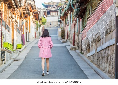 Tourist walking at Bukchon Hanok Village Traditional Korean style architecture in Seoul City, Seoul, South Korea.