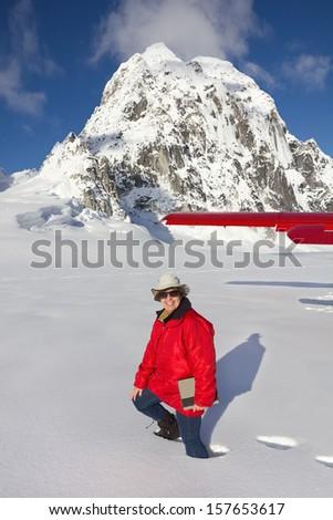 Tourist Walking in Deep Snow after Plane Landing on Pika Glacier in Denali National Park, Alaska near Mount McKinley