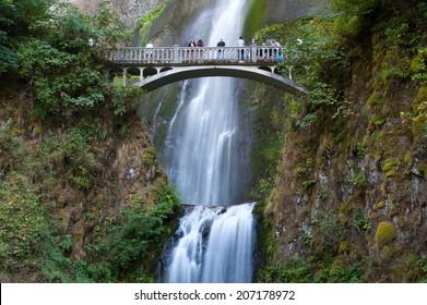 Tourist walking over Multnomah Falls