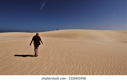 tourist walking through the dunes, Corralejo dunes natural park, dunes on the island of Fuerteventura, canary islands