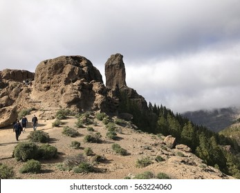 Tourist walking towards the Roque Nublo a volcanic rock on the island of Gran Canaria