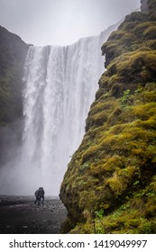 A tourist walks up to the famous Skogafoss waterfall in Iceland.