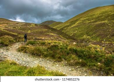 The tourist walks in the mountains. Cairngorms National Park. Braemar, Aberdeenshire, Scotland, United Kingdom.