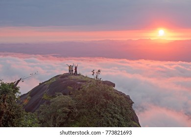 the tourist Watch the sunrise on the mountain in a beautiful thailand park.