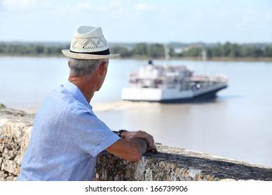 Tourist watching a ferry