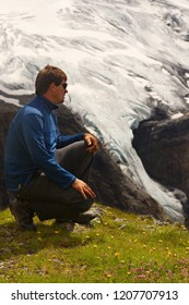 Tourist watching a mountain landscape with glaciers on a background
