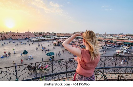 Tourist watching over Jamaa el-Fna Market Marrakesh - Morocco. Sunset view.
