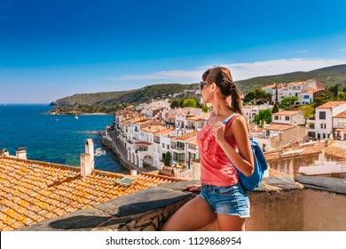 Tourist woman in Cadaques, Catalonia, Spain near of Barcelona. Scenic old town with nice beach and clear blue water in bay. Famous resort destination in Costa Brava with Salvador Dali landmark
