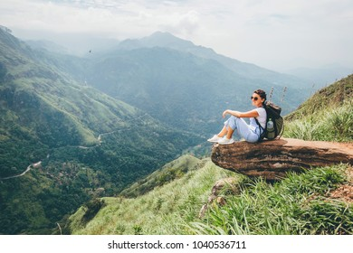 Tourist woman enjoy with beautiful view on mountains in Ella, Sri Lanka