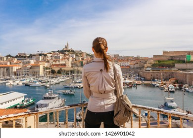 Tourist woman in French historical city Marseille and Mediterranean sea coast. Marseille is the biggest port in France, South Europe. Famous large city and tourist destionation.