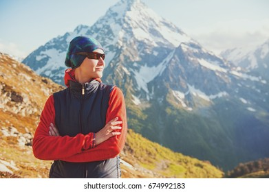 Tourist woman hiker on the top of mountain outdoor