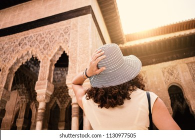 Tourist woman looking at Alhambra Palace. Granada, Andalucia.