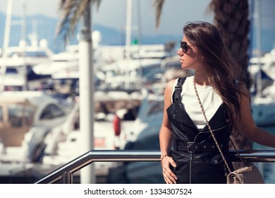 Tourist woman looking at harbour, Port Pierre Canto, Cannes, France.