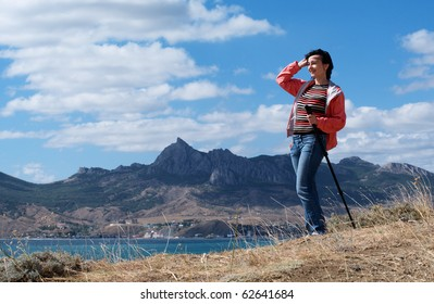 Tourist woman in mountains by the sea