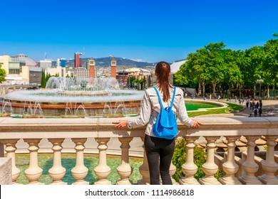 Tourist woman see on skyline of beautiful Barcelona from the Montjuic in a clear blue sky and sunny day. Famous tourist destination Catalonia, Spain