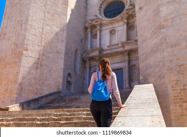 Tourist woman see in Onyar in Girona, Catalonia, Spain. Scenic ancient town. Famous tourist resort destination perfect place for holiday and vacation