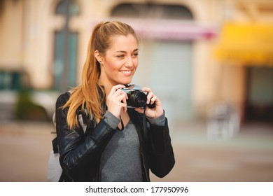 Tourist woman sited taking pictures