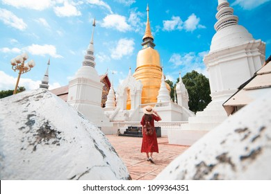 Tourist woman is traveling and sightseeing at Wat Suan Dok in Chiangmai, Thailand.
