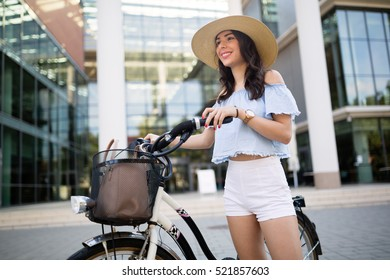 Tourist woman using bicycle as means of transport