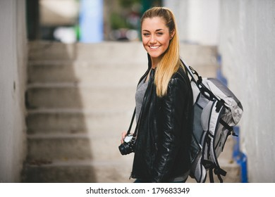 Tourist woman walking arround the city