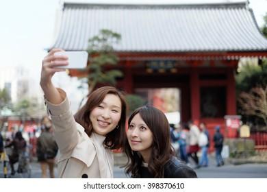 Tourist women taking selfie at Tokyo