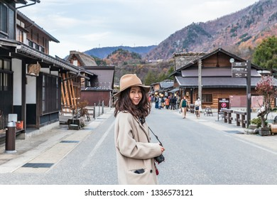 Tourist women walking around Shirakawago in the fall .It is a village with beautiful scenery reminiscent of the old days. The village has a Gassho-style house.Gifu,Japan
