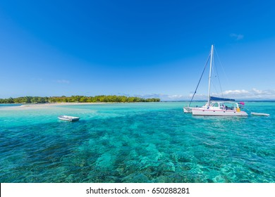Tourist yachts sailing along Gabriel and Flat Tropical Islands off Mauritius Beach