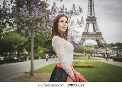 Tourist young woman at eifel tower Paris